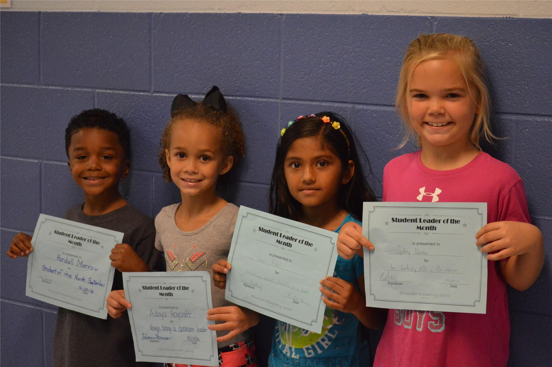 (L-R) Kindergartener, Randall Morrow; 2nd graders:  Adaya Hayacraft, Heer Patel, Sydney Newman
