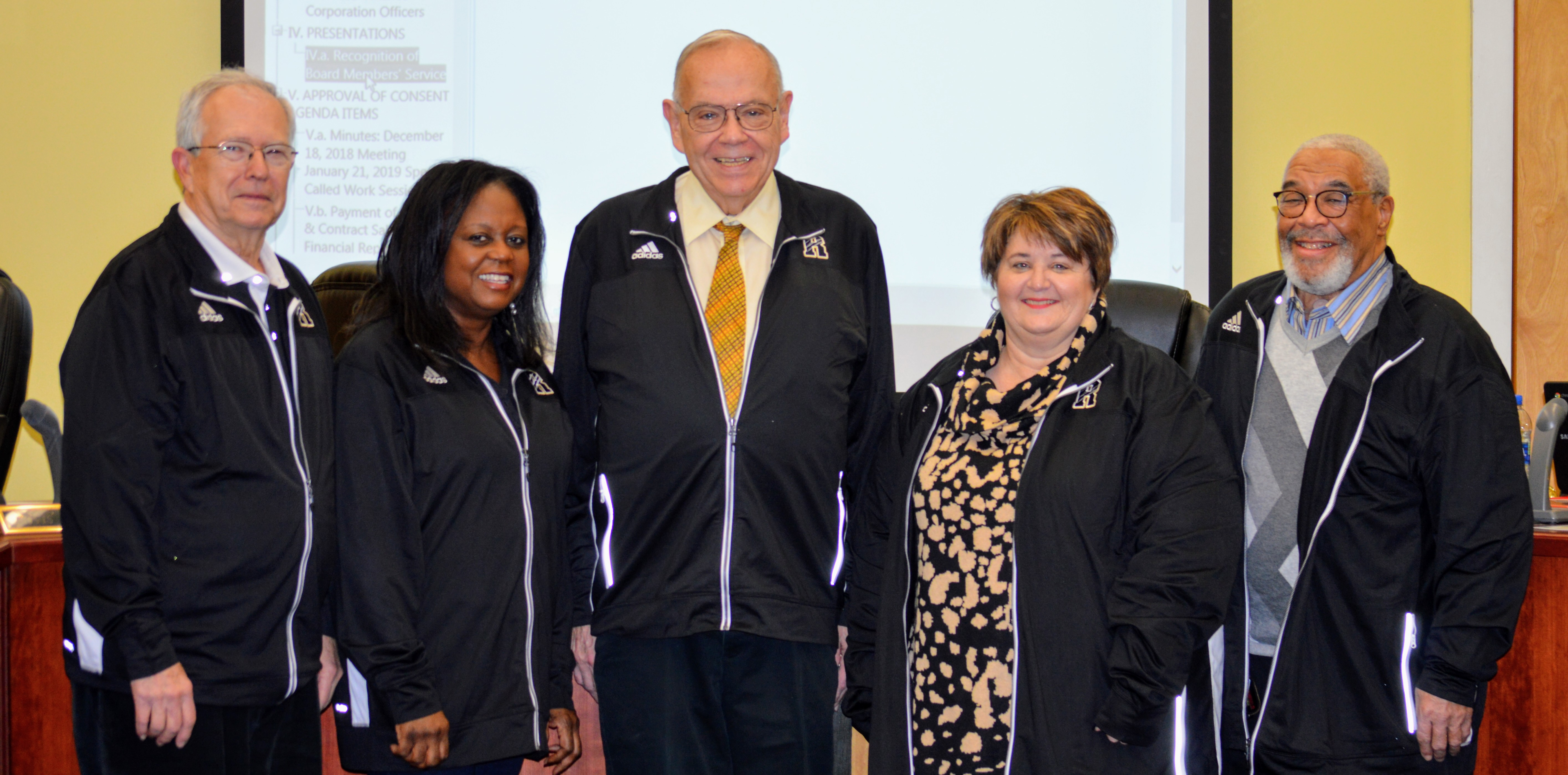 Russellville Board of Education members Joe Sparks, Lovis Patterson, James Milam, Davonna Page, and Phillip West